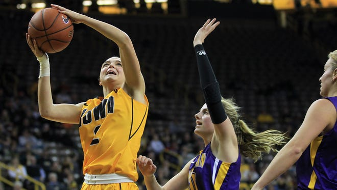 Iowa's Ally Disterhoft takes a shot during the Hawkeyes' game against UNI at Carver-Hawkeye Arena on Tuesday, Nov. 25, 2014.  David Scrivner / Iowa City Press-Citizen