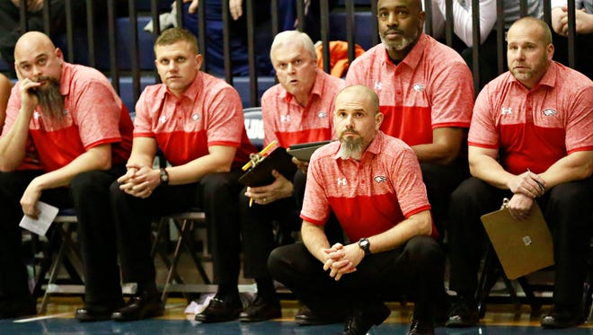 Dover head coach Brian Schmoyer, front, is stepping down after 14 years at the helm. DISPATCH FILE PHOTO
