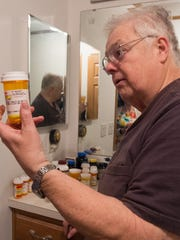 Gary Stumpf of Dover holds a bottle of one of his diabetes medications.  Gary has had diabetes for 20 years.