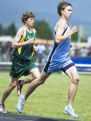 Teagan Olson of Great Falls High, right, hopes he will be challenging C.M. Russell's Cooper West at Sunday's Ice Breaker five-mile race through the streets of Great Falls, much like they did during this undated track meet.