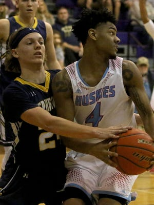 Hirschi's Javen Banks spins away from Stephenville's Mason Holstein Saturday, Feb. 24, 2018, in the Region I-4A area round playoff game in Jacksboro. The Huskies defeated the Yellow Jackets 85-48.