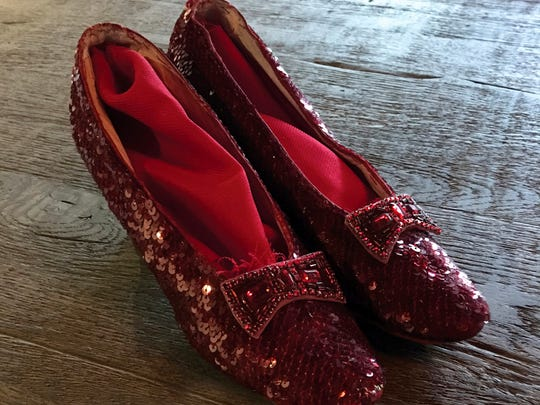 "The replica ruby slippers from ""The Wizard of Oz,"""