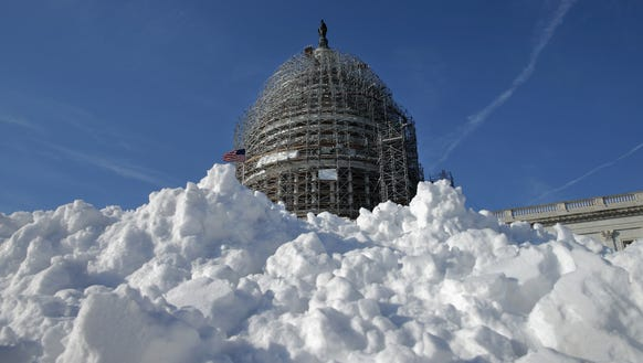 A pile of shoveled snow sits outside the U.S. Capitol