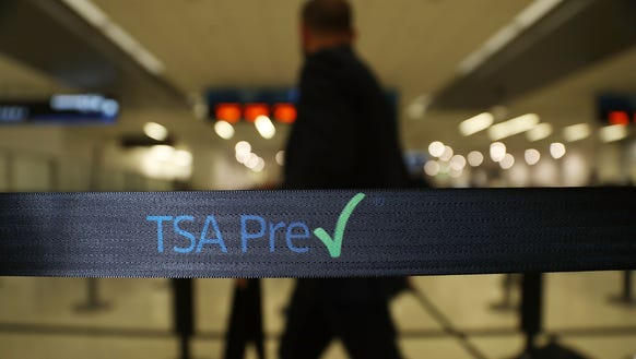 Travelers go through the TSA PreCheck security point