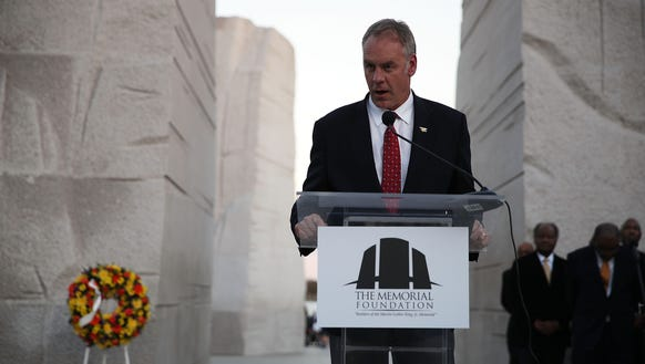 Interior Secretary Ryan Zinke speaks during a candlelight
