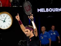 Serbia's Novak Djokovic returns a forehand shot against Japan's Yoshihito Nishioka in their third round singles match at the Australian Open tennis championship in Melbourne, Australia, Friday, Jan. 24, 2020. (AP Photo/Lee Jin-man)