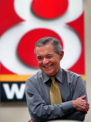 Mike Ahern shares a laugh in the WISH-8 newsroom shortly
