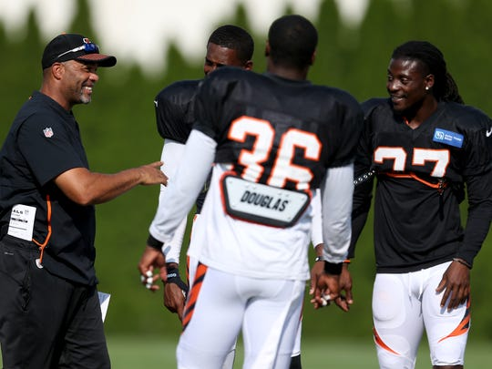 Cincinnati Bengals defensive coordinator Teryl Austin shares a laugh with Cincinnati Bengals defensive back George Iloka (43), Cincinnati Bengals defensive back Dre Kirkpatrick (27) and Cincinnati Bengals defensive back Shawn Williams (36) during Cincinnati Bengals training camp practice, Friday, Aug. 3, 2018, on the practice fields next to Paul Brown Stadium in Cincinnati.