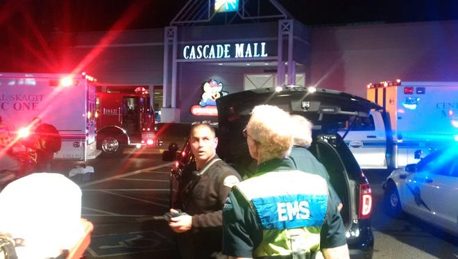 epa05553881 A handout photograph made avaliable by Washington State Patrol showing officers at the scene of the shooting at the Cascade Mall in Burlington, Wash.