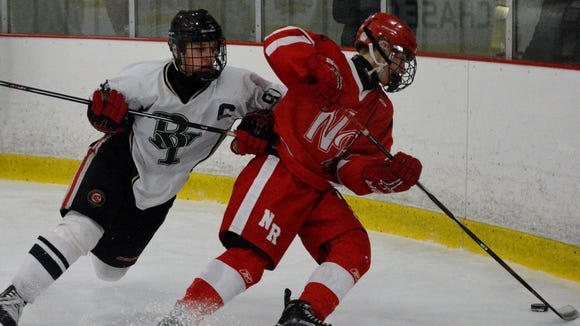 Brewster/Yorktown's Connor Sullivan (left) battles