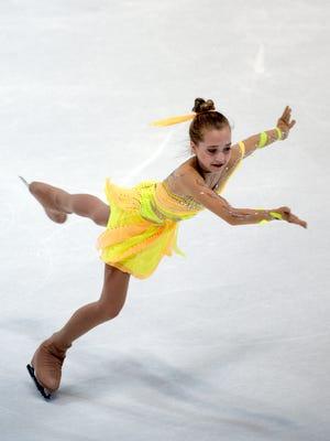 Elena Radionova claimed the women's title at the Nebelhorn Trophy figure skating competition.