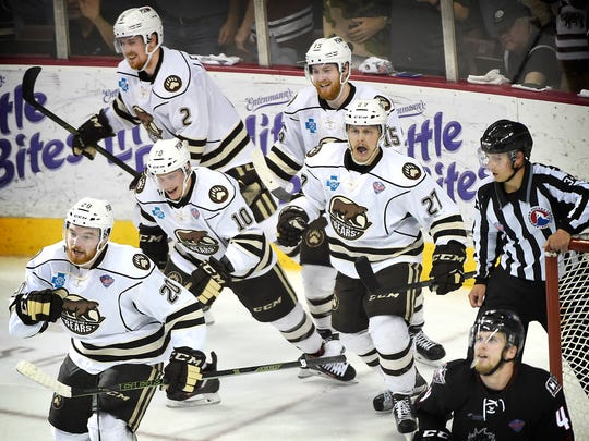 The Hershey Bears celebrate in the third period after Liam O'Brien (20), assisted by Travis Boyd (15) and Aaron Ness (27), scores a goal to pull the Bears within one goal. Despite a rally in the third period, the Bears dropped game two of the Calder Cup finals in Hershey Friday night, 5-3.