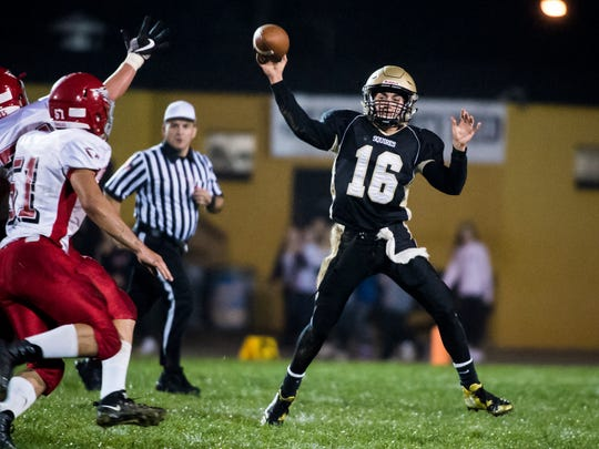 Delone Catholic's Evan Brady (16) throws the ball against Bermudian Springs on Friday, Oct. 13, 2017. The Squires fell in overtime 10-7.
