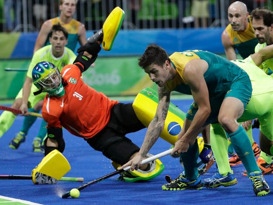 NZ tops Belgium, keeps Britain out of field hockey quarters
