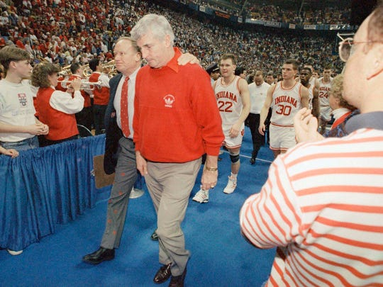 Indiana coach Bobby Knight, right, walks off the court with assistant coach Norm Ellenberger after Knights top-seeded Hoosiers lost to Kansas 83-77 in the NCAA Midwest Regional Championship game, March 27, 1993.