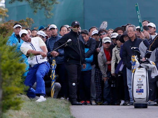 tInternational team player Jason Day of Australia plays from the rough during his singles match against United States' Zach Johnson at the Presidents Cup on the Jack Nicklaus Golf Club Korea, in Incheon, South Korea, Sunday, Oct. 11, 2015.(AP Photo/Woohae Cho)