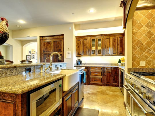 The home's gourmet kitchen features cherry-stained