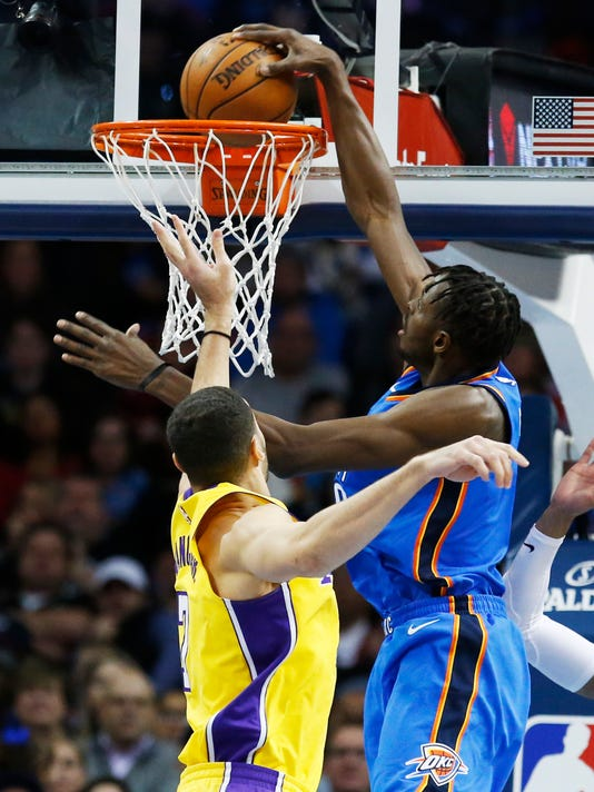 Oklahoma City Thunder forward Jerami Grant, right, dunks in front of Los Angeles Lakers forward Larry Nance Jr., left, in the first half of an NBA basketball game in Oklahoma City, Wednesday, Jan. 17, 2018. (AP Photo/Sue Ogrocki)