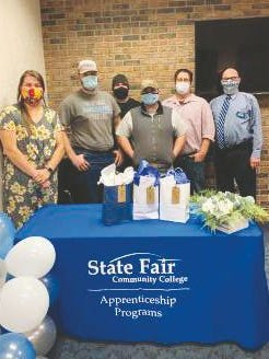 State Fair Community College celebrated National Apprenticeship Week Nov. 9-13 by recognizing student-apprentices during their classes on the Sedalia campus. (Class 630, left to right) Sarah Manuel, SFCC Apprenticeship coordinator; Scott Manuel of Mora; Alex Colli of California, Missouri; Charles Davidson of Sedalia; Brady Glover, SFCC Industrial Electrical Maintenance instructor; Michael Rogg, SFCC Technical Education and Workforce Innovation dean.