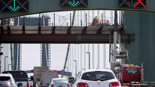 Northbound traffic heading into New Jersey as crews with Blastech Enterprises, Inc. continue work on the removal of layers of old paint and repainting the Delaware Memorial Bridge. The project is costing the Delaware River and Bridge Authority about $12.9 million.