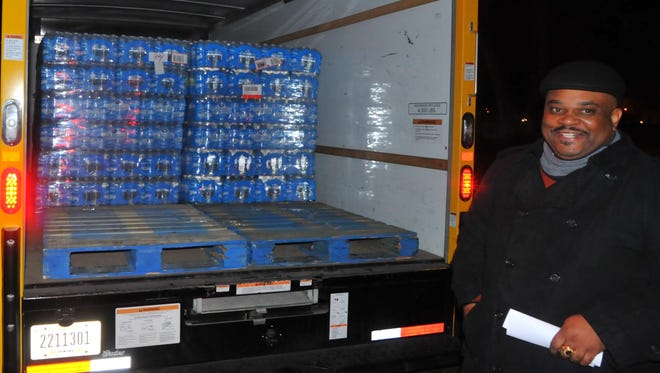 Bishop G. Wesley Bennett smiles as donations are placed in a truck headed for Flint, Michigan.