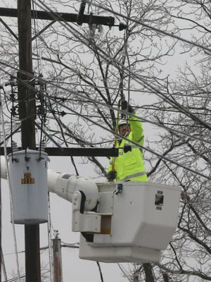 Daniel Burks with the Mufreesboro Electric Department works to repair an electrical line on Bell street that was damage due to the weather, on Monday Feb. 16, 2015.
