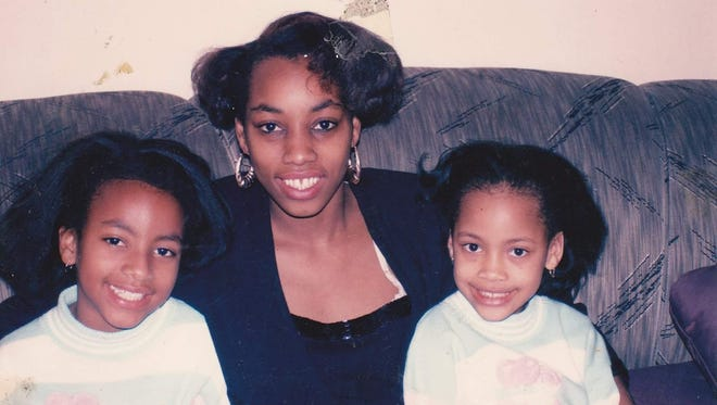 Tiffany McFadden, right, at age 6, with her mother and sister.