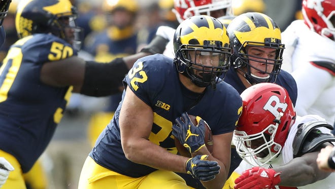 Michigan's Ty Isaac runs the ball against Rutgers in the second quarter Saturday, Oct. 28, 2017 at Michigan Stadium.