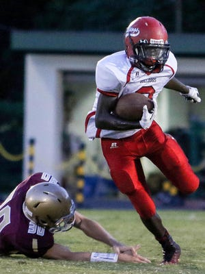 Laurel's Traevon Dixon was part of a devastating rushing attack as the Bulldogs defeated St. Elizabeth 29-12.