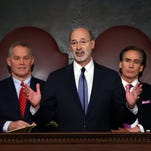Gov. Tom Wolf, center, delivers his budget address for the 2016-17 fiscal year to a joint session of the Pennsylvania House and Senate, as the speaker of the state House of Representatives, state Rep. Mike Turzai, R-Allegheny, left, and Lt. Gov. Mike Stack, right, listen at the State Capitol in Harrisburg, Pa., Tuesday, Feb. 9, 2016. (AP Photo/Chris Knight)