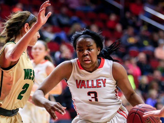 Valley's Zoe Young drives to the hoop in the 5A state