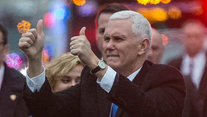 Vice President of the United States Mike Pence gives two thumbs up to the crowds while walking in the Inaugural Parade on Pennsylvania Avenue, Washington D.C., on Jan. 20, 2017.