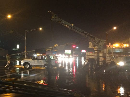 Crews work to clear the intersection of Central Avenue