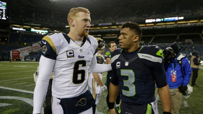 Seattle Seahawks quarterback Russell Wilson, right, greets St. Louis Rams' Johnny Hekker after an NFL football game, Sunday, Dec. 27, 2015, in Seattle.