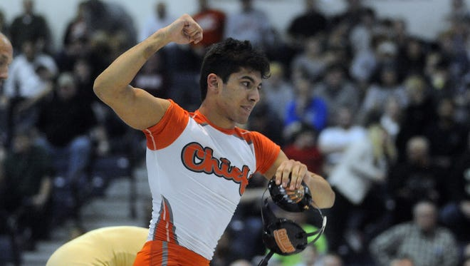 Collin Wickramaratna of Cherokee celebrates his win over Andrew Clark of Collingswood in their 126-pound final at Saturday's Region 7 wrestling championships at Toms River North High School.