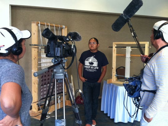 """Northern Diné Youth Committee member Eliseo Curley is interviewed by filmmaker Ramona Emerson in this production still from """"The Mayors of Shiprock."""""""