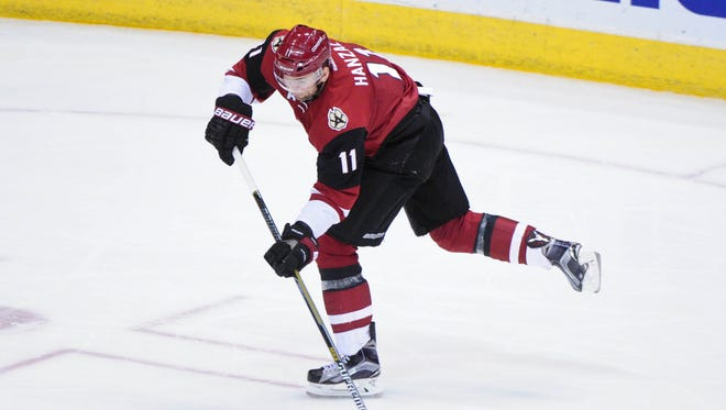Mar 19, 2016: Arizona Coyotes center Martin Hanzal (11) shoots the puck during the second period against the Tampa Bay Lightning at Gila River Arena.