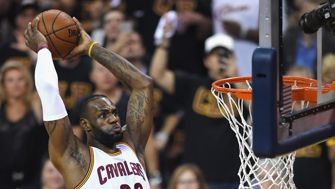 LeBron James dunks in the Cavaliers' Game 6 victory.