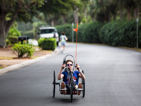 Edie Perkins trains for the Naples Daily News Half Marathon on her handcycle in the Naples Bath and Tennis Club neighborhood where her parents live on Wednesday, Jan. 10, 2018.