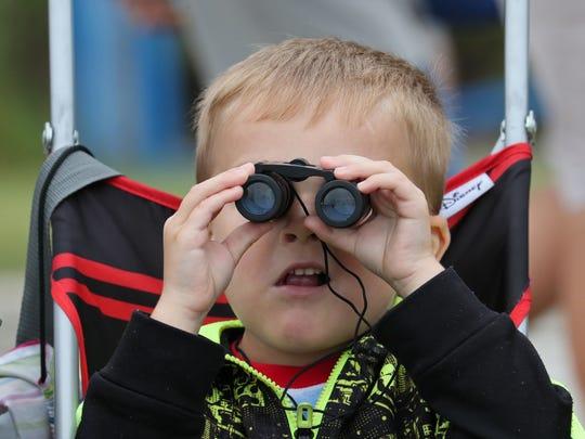 Salih Kicic, 5, of Milwaukee scans the horizon for