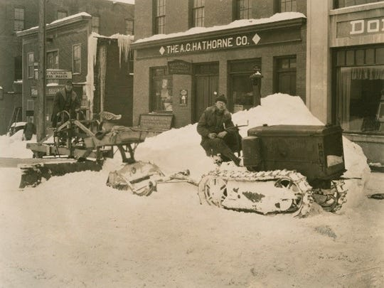 A tractor with treads pulling a plow on South Winooski Avenue, probably in the 1920s.