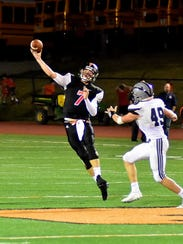 Quarterback Jay Volpenhein fires a touchdown pass for