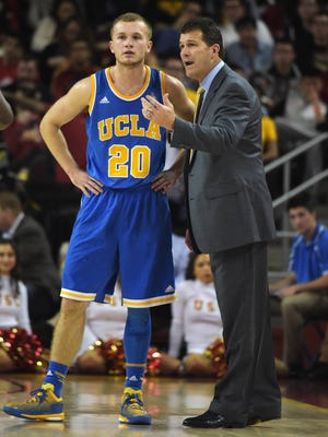 UCLA Bruins coach Steve Alford  talks with his son Bryce Alford during the game against the Southern California Trojans.