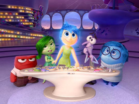 """In this image released by Disney-Pixar, characters, from left, Anger (Lewis Black), Disgust (Mindy Kaling), Joy (Amy Poehler), Fear (Bill Hader) and Sadness (Phyllis Smith) appear in a scene from """"Inside Out."""""""
