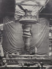 "Holiday Folk Fair International's ""Images of Liberty"" exhibit will celebrate the great symbol of welcome and freedom. This photo depicts the future Statue of Liberty's hand and torch being prepared for a fundraising trip to the United States in 1875-'76."