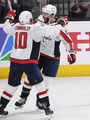 Washington Capitals defenseman Brooks Orpik, celebrating his goal with Brett Connolly, is old school and an ultimate pro, says teammate T.J. Oshie.