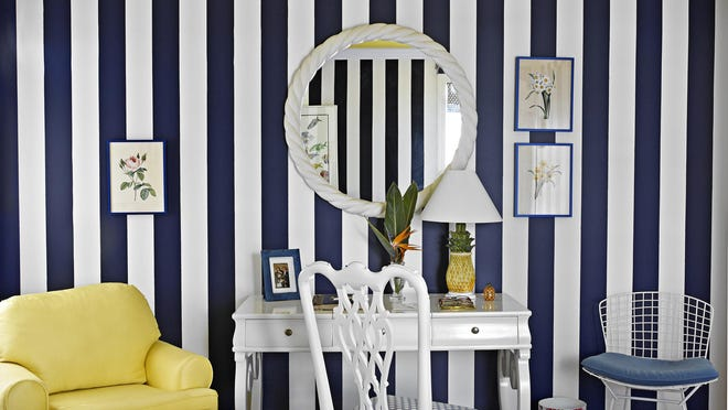 For some of the walls of his Palm Beach home, Carleton Varney used bold stripes of white and Classic Blue, Pantone's color of the year for 2020.