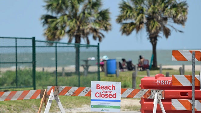 People go to the beach, Friday, July 3, 2020, at North Beach. The city of Corpus Christi closed vehicle access to parks and beaches Friday, July 3 to Tuesday, July 7 to prohibit crowding for the Fourth of July weekend.