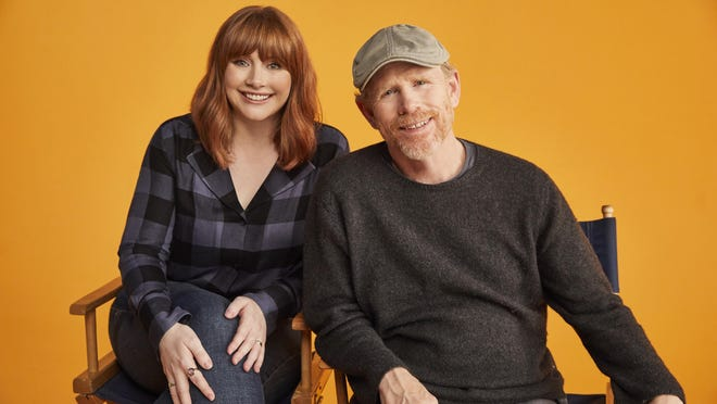 """Bryce Dallas Howard is shown with her father, Ron Howard. She directs and he appears in the documentary """"Dads."""""""