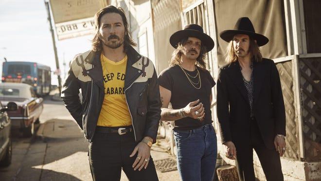 Midland (l-r: Mark Wystrach, Cameron Duddy, Jess Carson) in front of Sam's BBQ in Austin.